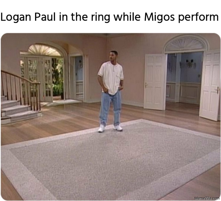 Logan Paul in the ring while Migos perform meme